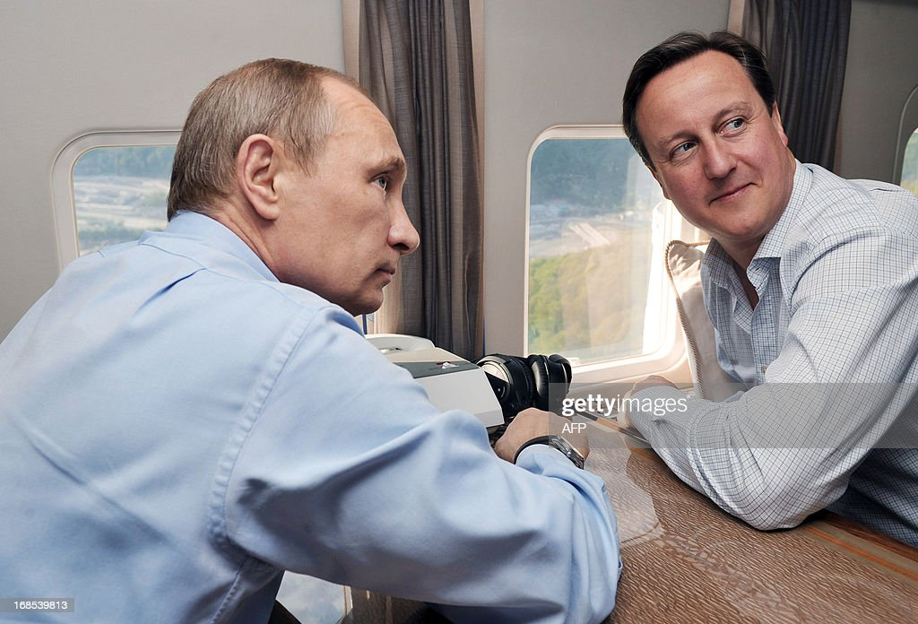 Russian President Vladimir Putin (L) and Britain's Prime Minister David Cameron fly by helicopter to inspect the 2014 Winter Olympic facilities after their meeting at the Bocharov Ruchei state residence in Sochi on May 10, 2013. Britain and Russia on May 10 sought to forge a joint approach to the crisis in Syria, as US Secretary of State John Kerry said there was 'strong evidence' Damascus had used chemical weapons against rebels. AFP PHOTO / RIA NOVOSTI / PRESDIENTIAL PRESS SERVICE / ALEXEY NIKOLSKY