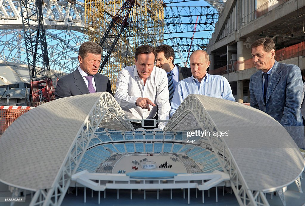 Russian President Vladimir Putin (2nd R) and Britain's Prime Minister David Cameron (2nd L) look at a model of a stadium during a visit to the 2014 Winter Olympic venues after their meeting at the Bocharov Ruchei state residence in Sochi on May 10, 2013. Britain and Russia on May 10 sought to forge a joint approach to the crisis in Syria, as US Secretary of State John Kerry said there was 'strong evidence' Damascus had used chemical weapons against rebels.