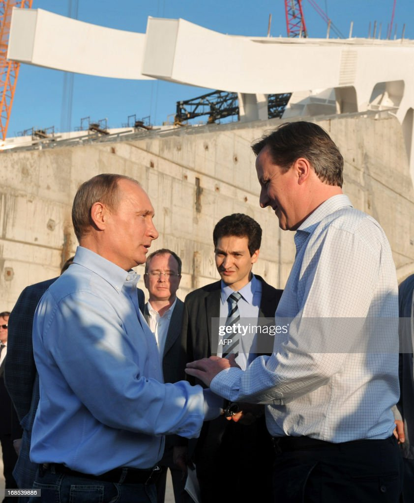 Russian President Vladimir Putin (L) and Britain's Prime Minister David Cameron (R) shake hands during a visit to the 2014 Winter Olympic venues after their meeting at the Bocharov Ruchei state residence in Sochi on May 10, 2013. Britain and Russia on May 10 sought to forge a joint approach to the crisis in Syria, as US Secretary of State John Kerry said there was 'strong evidence' Damascus had used chemical weapons against rebels.