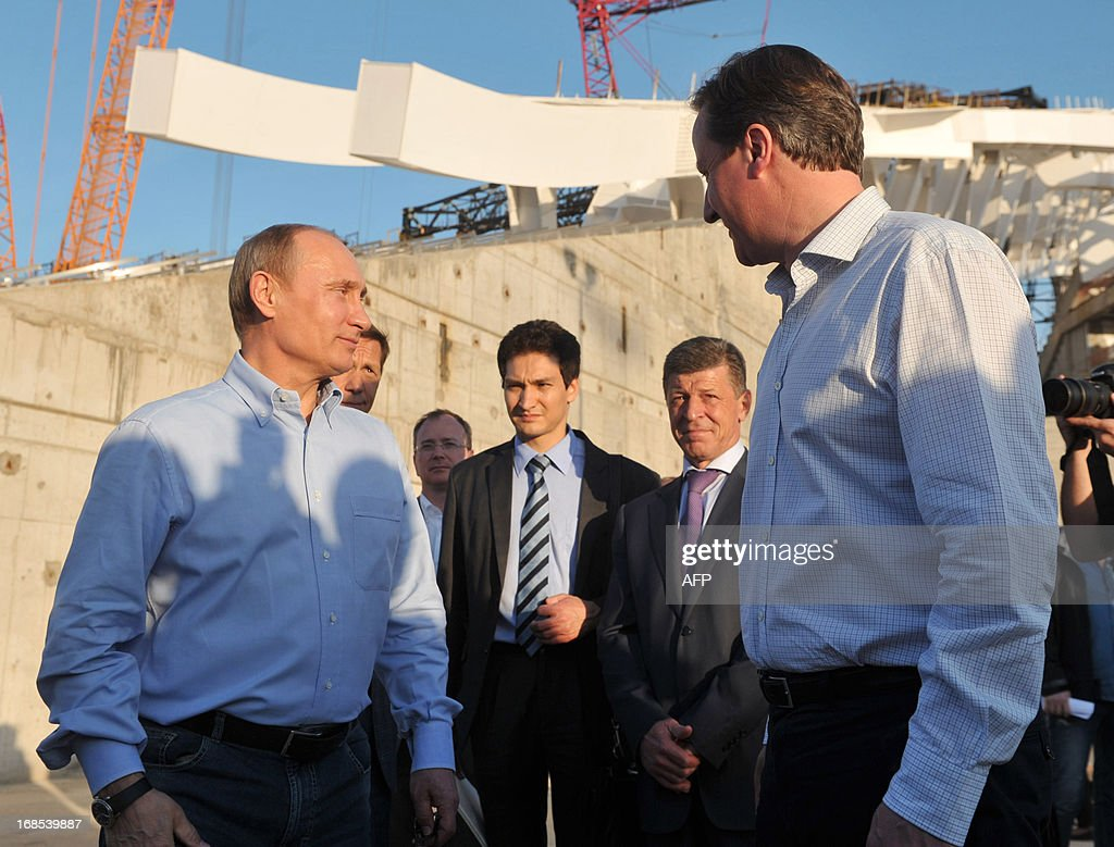 Russian President Vladimir Putin (L) and Britain's Prime Minister David Cameron (R) listen to explanations during a visit to the 2014 Winter Olympic venues after their meeting at the Bocharov Ruchei state residence in Sochi on May 10, 2013. Britain and Russia on May 10 sought to forge a joint approach to the crisis in Syria, as US Secretary of State John Kerry said there was 'strong evidence' Damascus had used chemical weapons against rebels. AFP PHOTO / RIA NOVOSTI / PRESDIENTIAL PRESS SERVICE / ALEXEY NIKOLSKY