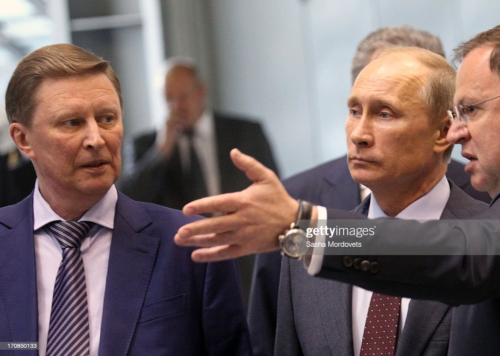 Russian President Vladimir Putin (C) and Chief of Presidential Administration Sergey Ivanov (L) visit the Obukhov state plant on June 19, 2013 in in Saint Petersburg, Russia. Putin held a meeting at the plant on the development and implementation of military services and equipment.