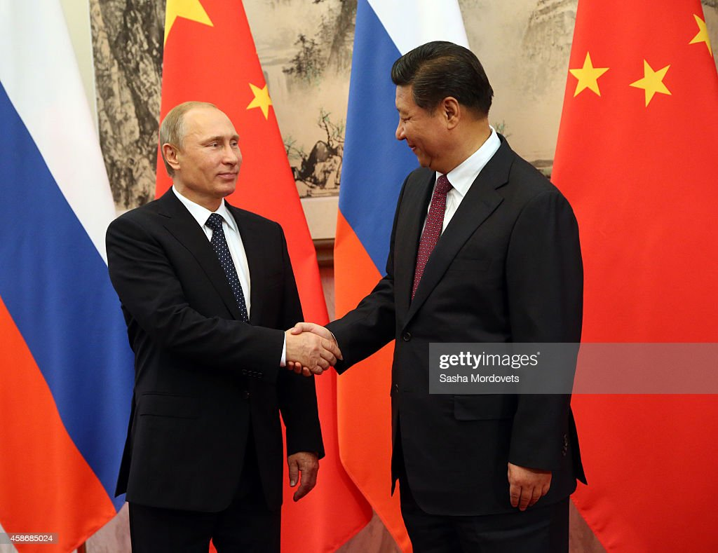 Russian President Vladimir Putin and Chinese President Xi Jinping attend a Bilateral Meeting at the Diaoyutai State Guesthouse during the AsiaPacific...