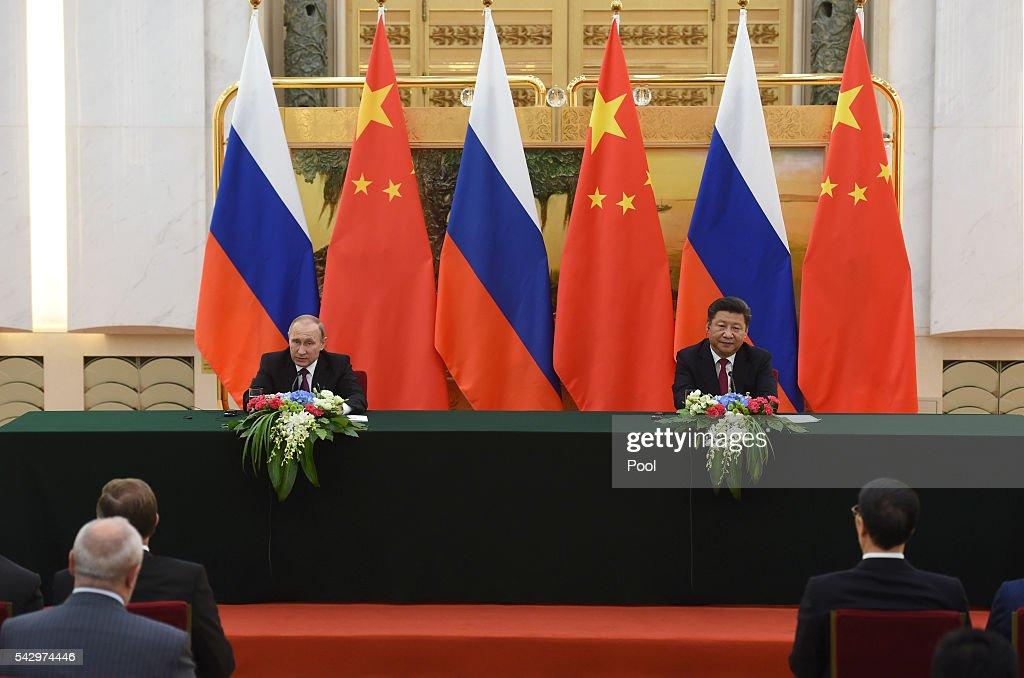 Russian President Vladimir Putin (L) and Chinese President Xi Jinping attend a joint press briefing in Beijing's Great Hall of the People on June 25, 2016 in Beijing, China. Russian President Vladimir Putin is in China to discuss more economic and military cooperation between the two countries.