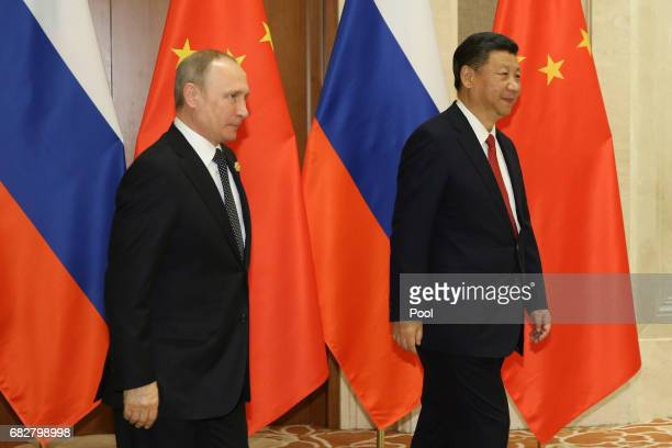 Russian President Vladimir Putin and Chinese President Xi Jinping arrive for a bilateral meeting at Diaoyutai State Guesthouse in Beijing China 14...