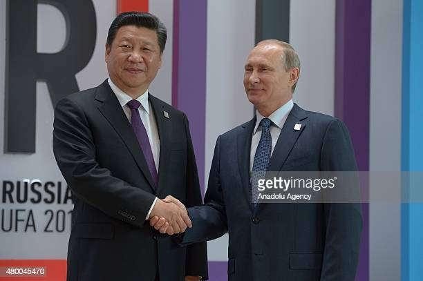 Russian President Vladimir Putin and Chinese President Xi Jinping shake hands during the second day of SCO and BRICS summit in Ufa the capital of the...