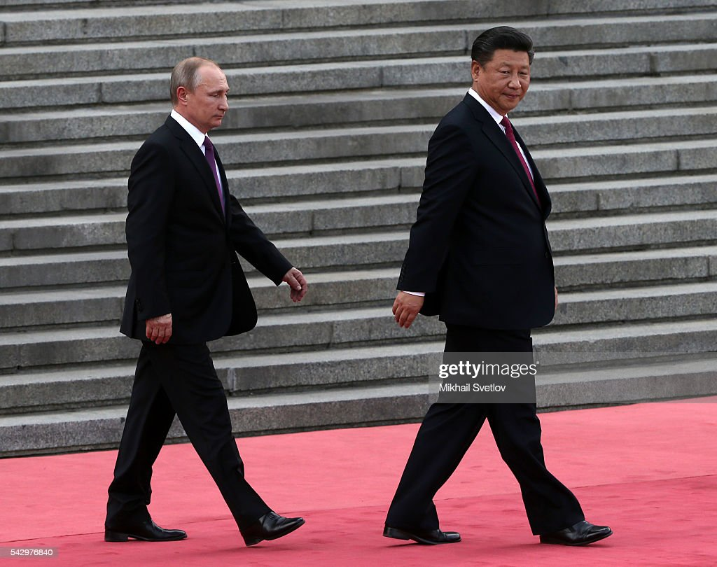 Russian President Vladimir Putin (L) and Chinese President Xi Jinping (R) attends the welcoming ceremony in June 25, 2016 in Beijing, China. Vladimir Putin is having a state visit to China.