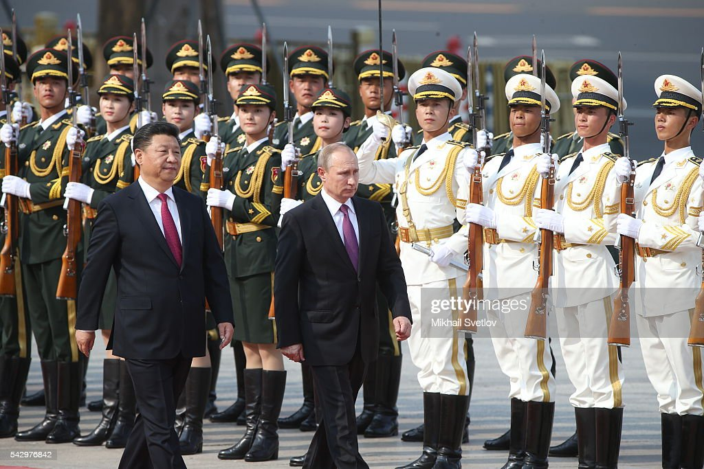 Russian President Vladimir Putin (R) and Chinese President Xi Jinping (L) attends the welcoming ceremony in June 25, 2016 in Beijing, China. Vladimir Putin is having a state visit to China.