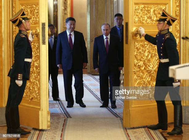 Russian President Vladimir Putin and Chinese President Xi Jinping enter the hall at the Grand Kremlin Palace on July 4 2017 in Moscow Russia Chinese...