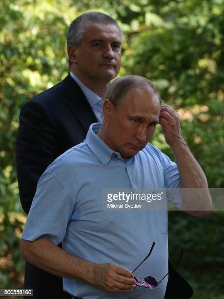 Russian President Vladimir Putin and Crimea Governor Sergey Aksyonov are seen walking in Artek camp an international children center on the Black Sea...
