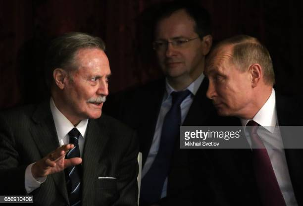 Russian President Vladimir Putin and Culture Minister Vladimir Medinsky listen to theatre direcor Yuri Solomin as they visit the Maly Theatre to...