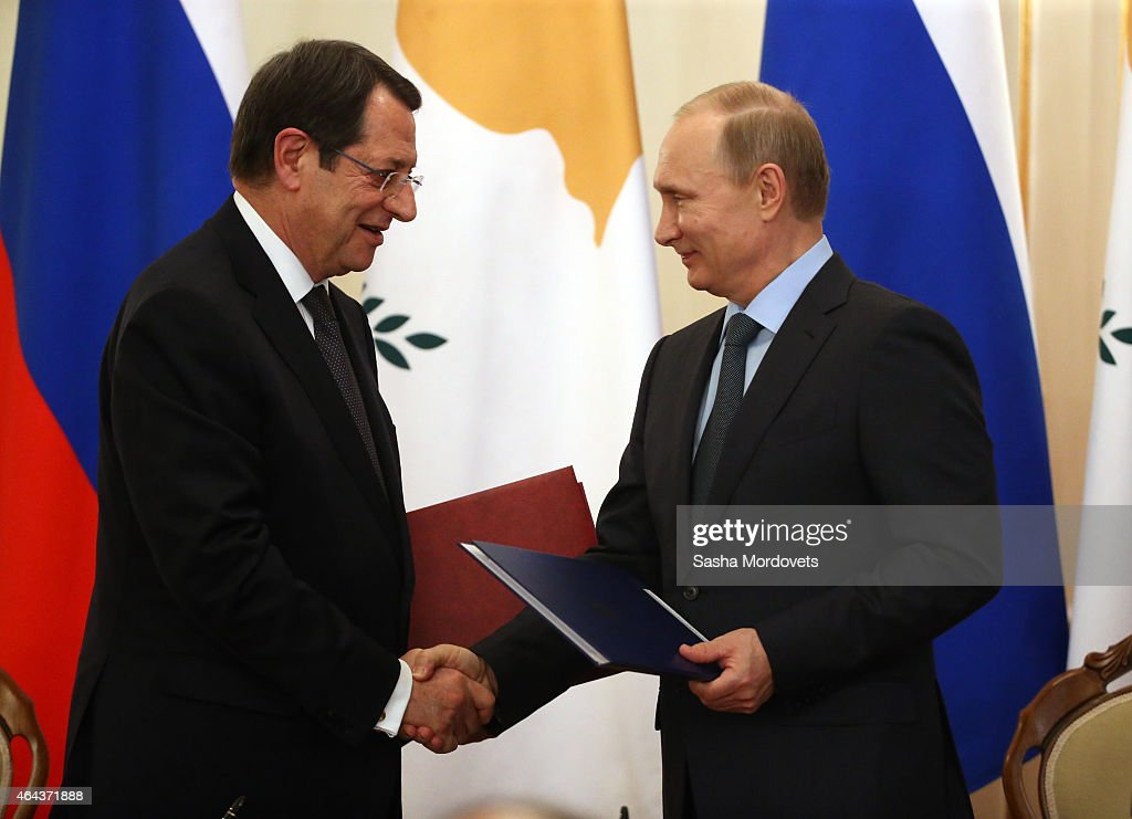 Russian President <a gi-track='captionPersonalityLinkClicked' href=/galleries/search?phrase=Vladimir+Putin&family=editorial&specificpeople=154896 ng-click='$event.stopPropagation()'>Vladimir Putin</a> (R) and Cyprus President <a gi-track='captionPersonalityLinkClicked' href=/galleries/search?phrase=Nicos+Anastasiades&family=editorial&specificpeople=10113933 ng-click='$event.stopPropagation()'>Nicos Anastasiades</a> (L) during a joint press conference in Novo Ogaryvo State Residence on February 25, 2015 in Moscow, Russia. During his one-day visit to the country, the Cypriot president signed a military agreement which would allow Russian ships to make port calls in Cyprus.