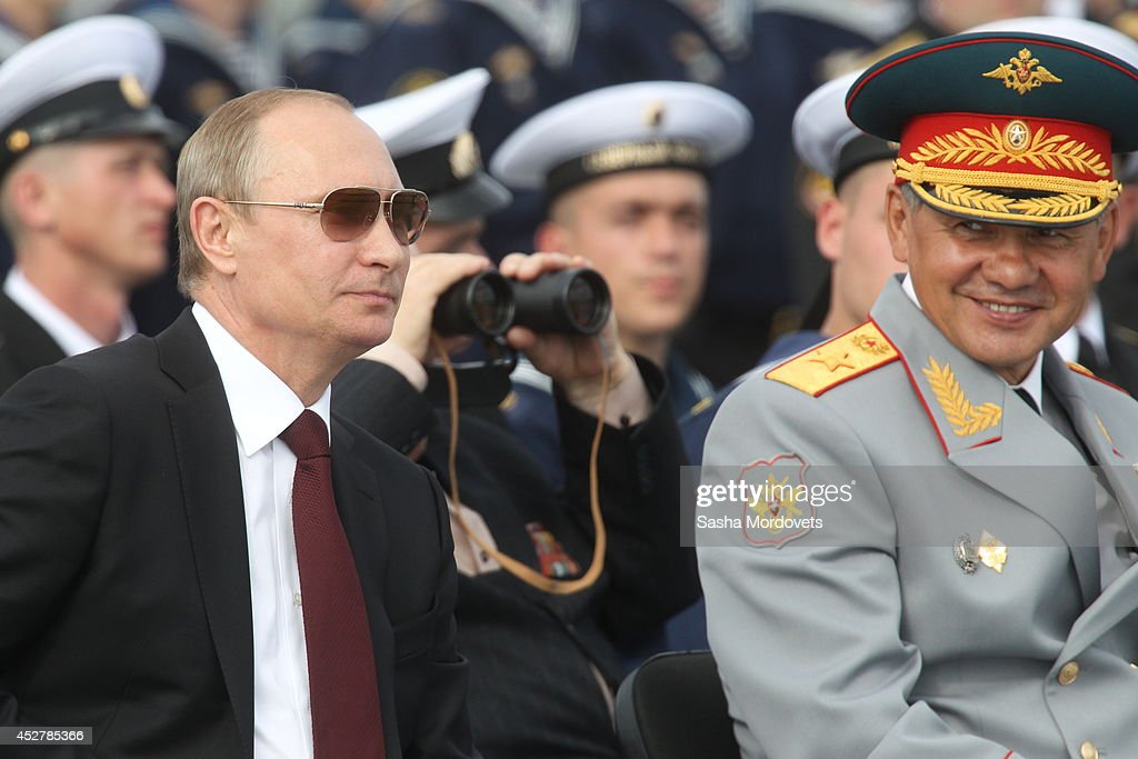 Russian President <a gi-track='captionPersonalityLinkClicked' href=/galleries/search?phrase=Vladimir+Putin&family=editorial&specificpeople=154896 ng-click='$event.stopPropagation()'>Vladimir Putin</a> and Defence Minister Sergei Shoigu (R) watch the Navy Day Military parade July 27, 2014 in Severomorsk. Putin is having a visit to Northern Fleet main naval base of Severomorsk.