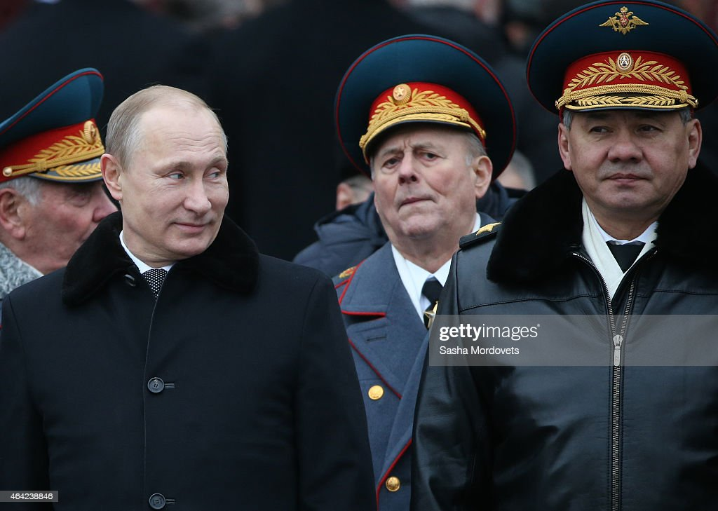 Russian President <a gi-track='captionPersonalityLinkClicked' href=/galleries/search?phrase=Vladimir+Putin&family=editorial&specificpeople=154896 ng-click='$event.stopPropagation()'>Vladimir Putin</a> (C) and Defence Minister Sergei Shoigu (R) attend a wreath laying ceremony at the tomb of the unknown soldier to mark the Defender of the Fatheland Day on February 23, 2015 in central Moscow, Russia. Originally known as 'Red Army Day' and later observed as 'Soviet Army and Navy Day', it was decreed a state holiday in 2002 after being renamed 'Defender of the Motherland Day'. The holiday marks the foundation of Red Army in 1918 and focuses on achievements of military forces and veterans.