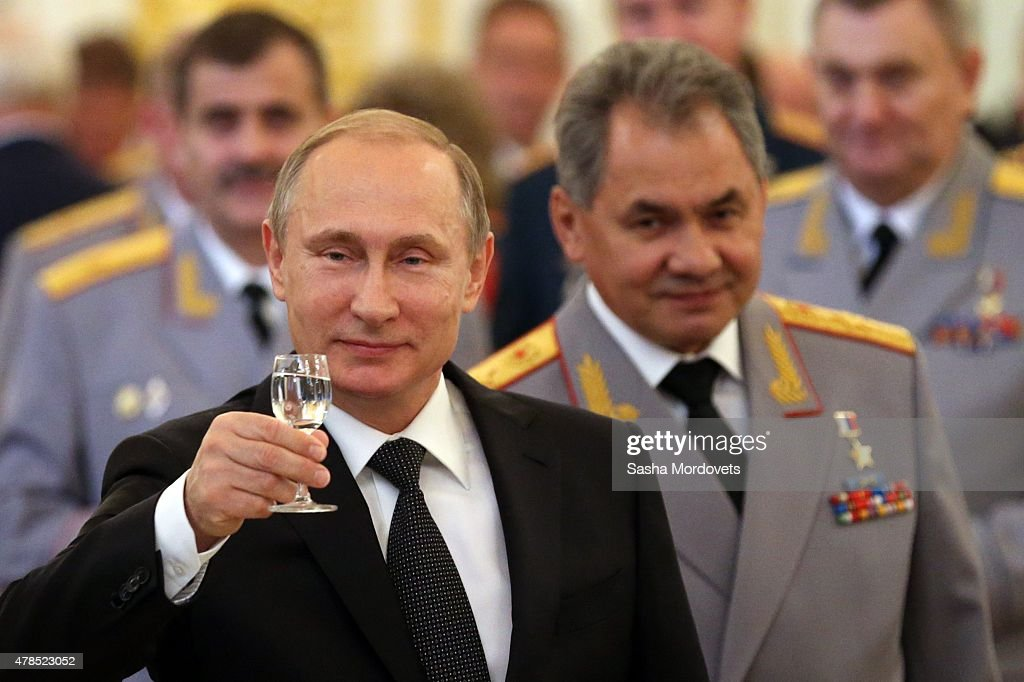 Russian President <a gi-track='captionPersonalityLinkClicked' href=/galleries/search?phrase=Vladimir+Putin&family=editorial&specificpeople=154896 ng-click='$event.stopPropagation()'>Vladimir Putin</a> (C) and Defence Minister Sergei Shoigu (R) toast during reception for graduated of military academies in the Grand Kremlin Palace on June 25, 2015 in Moscow, Russia. Russian President <a gi-track='captionPersonalityLinkClicked' href=/galleries/search?phrase=Vladimir+Putin&family=editorial&specificpeople=154896 ng-click='$event.stopPropagation()'>Vladimir Putin</a> is not done in eastern Ukraine, NATO's top commander said on Thursday, cautioning that Russia has been building up supplies on its border with Ukraine and keeping its military options open. U.S. General Philip Breedlove, NATO's supreme allied commander, said the border between Ukraine and Russia was 'wide open,' allowing free movement of equipment and supplies.