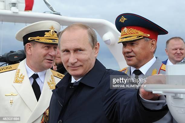 Russian President Vladimir Putin and Defence Minister Sergei Shoigu attend celebrations for Navy Day in Baltiysk in the Kaliningrad region on July 26...