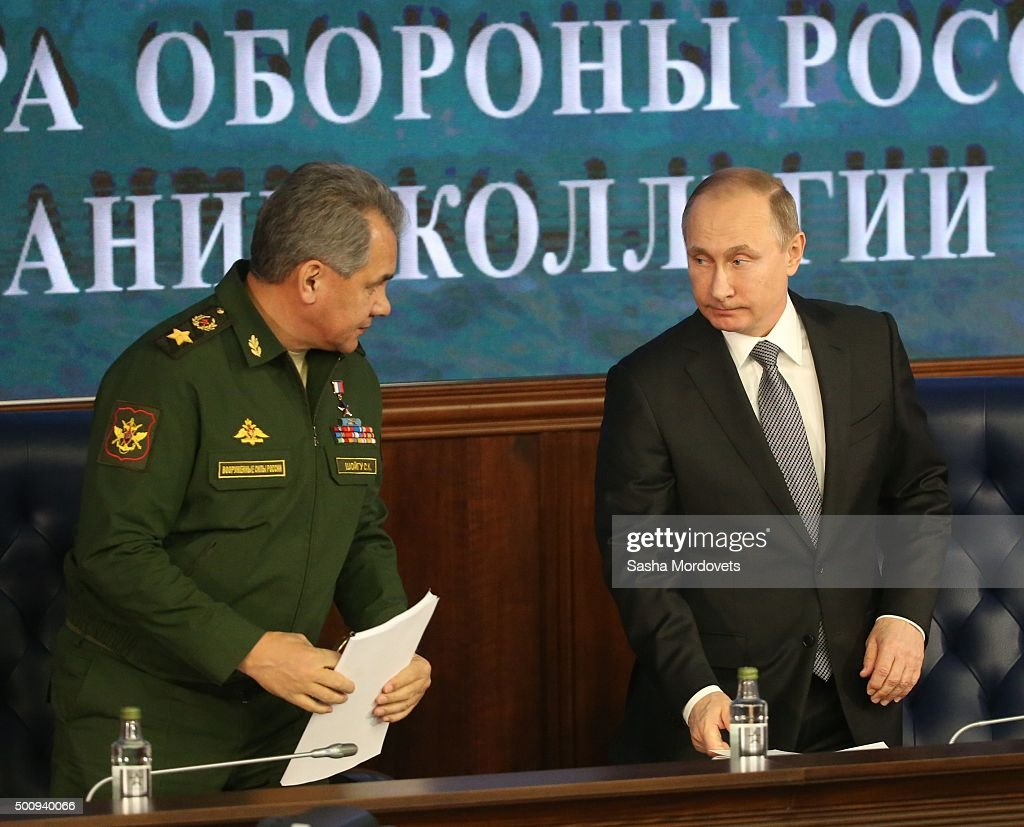 Russian President Vladimir Putin (R) and Defence Minister Sergei Shoigu (L) attend an annual meeting with high ranking officers of the Defence Ministry Board on December 11, 2015 in Moscow, Russia.. The President instructed that in undertaking its anti-terrorist operation in Syria, the Ministry of Defense must coordinate its actions with Israeli command and the US-led anti-Daesh coalition.