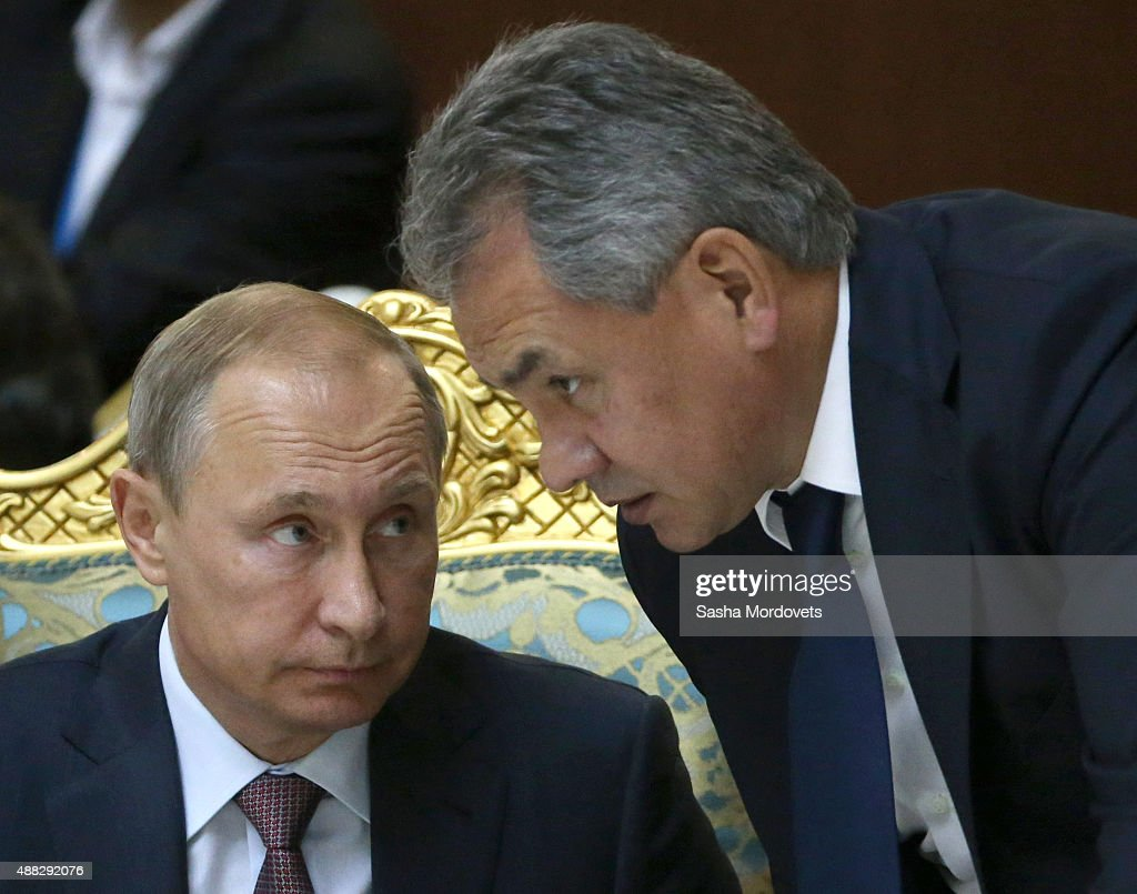 Russian President <a gi-track='captionPersonalityLinkClicked' href=/galleries/search?phrase=Vladimir+Putin&family=editorial&specificpeople=154896 ng-click='$event.stopPropagation()'>Vladimir Putin</a> (L) and Defence Minister Sergei Shoigu R() attend the Collective Security Treaty Organisation (CSTO) in Dushanbe, Tajikistan, September,15,2015. Putin said at a meeting of a Moscow-dominated security alliance of ex-Soviet nations in Tajikistan, that it's impossible to defeat the Islamic State group without cooperation with the government of Syria and that Moscow has provided military-technical assistance to President Bashar al-Assad's government and will continue to do so.