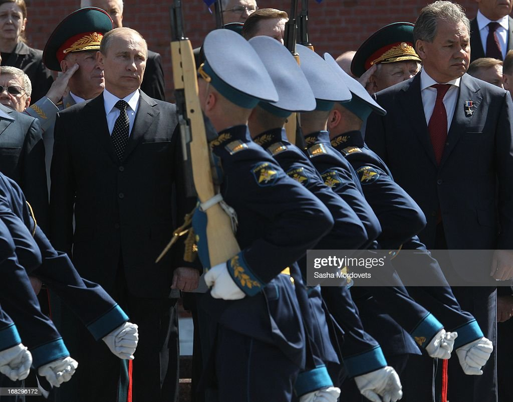 Russian President <a gi-track='captionPersonalityLinkClicked' href=/galleries/search?phrase=Vladimir+Putin&family=editorial&specificpeople=154896 ng-click='$event.stopPropagation()'>Vladimir Putin</a> (L) and Defence Minster Sergey Shoigu (R) attend a wreath laying ceremony at the Tomb of the Unknown Soldier near the Kremlin on May, 8 2013 in Moscow, Russia. Russia will hold victory parades tomorrow to mark the 68th anniversary of the defeat of Nazi Germany in World War II.