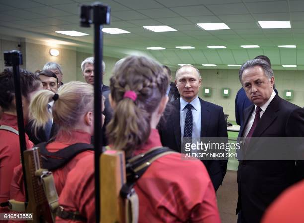 Russian President Vladimir Putin and Deputy Prime Minister Vitaly Mutko visit the Academy of Biathlon in Krasnoyarsk on March 1 2017 / AFP / SPUTNIK...