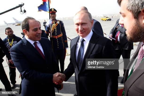 Russian President Vladimir Putin and Egyptian President Abdel Fattah elSisi attend a welcoming ceremony at the airport on December 11 2017 in Cairo...
