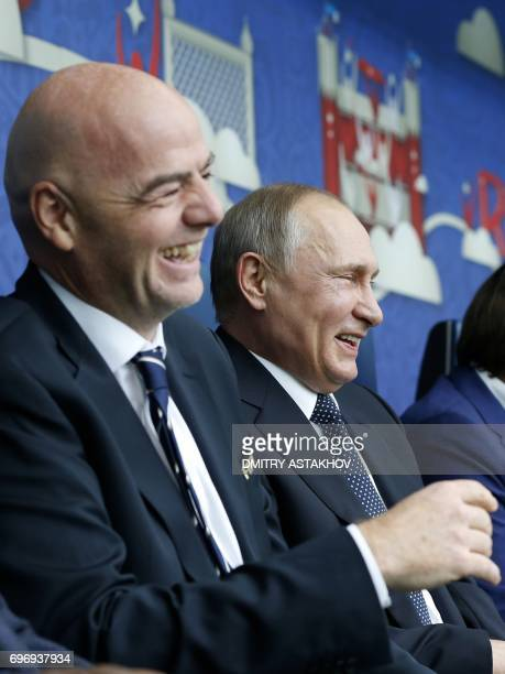 TOPSHOT Russian President Vladimir Putin and FIFA President Gianni Infantino laugh prior to the 2017 Confederations Cup group A football match...