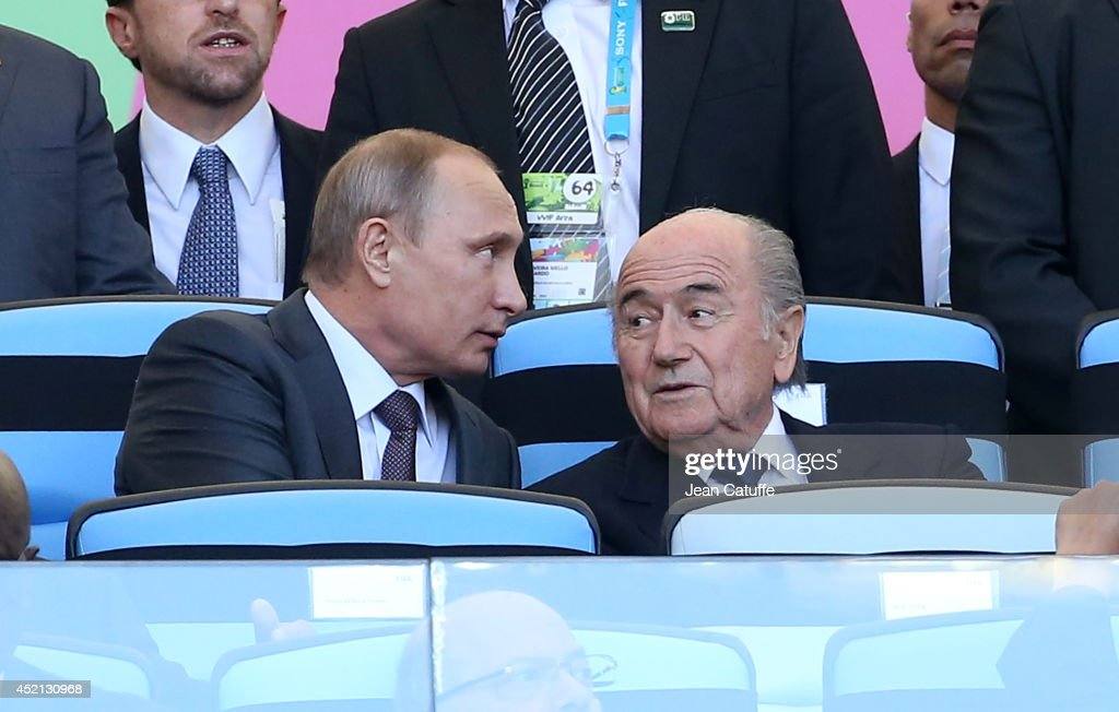 Russian President <a gi-track='captionPersonalityLinkClicked' href=/galleries/search?phrase=Vladimir+Putin&family=editorial&specificpeople=154896 ng-click='$event.stopPropagation()'>Vladimir Putin</a> and FIFA President Joseph Blatter attend the 2014 FIFA World Cup Brazil Final match between Germany and Argentina at Estadio Maracana on July 13, 2014 in Rio de Janeiro, Brazil.