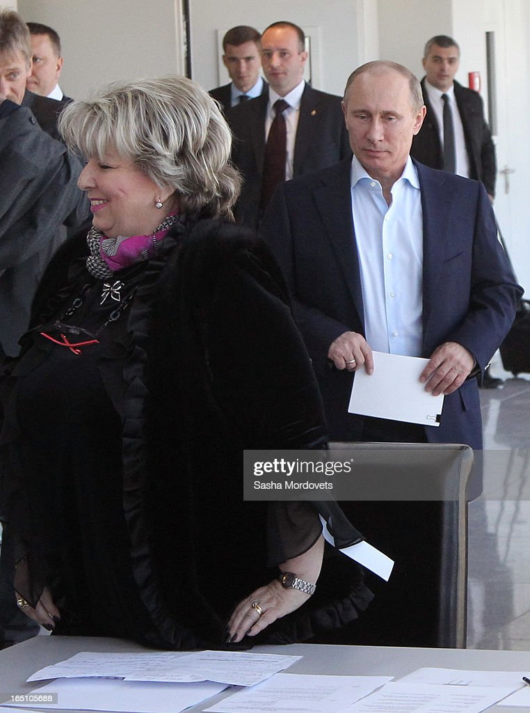 Russian President Vladimir Putin (R) and Figure Scating coach Tatiana Tarasova arrive to attend a meeting at the Bolshoy Ice Dome, an ice hockey arena in the Sochi Olympic Park on March, 2013 in Russia. Sochi will host the 2014 Winter Olympics.