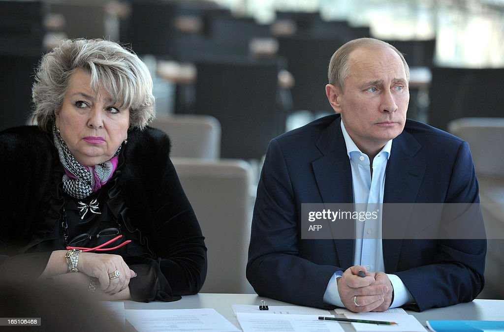 Russian President Vladimir Putin (R) and figure skating coach Tatyana Tarasova (L) attend a meeting with representatives of ice hockey and figure skating federations of Russia at the Bolshoy ice dome in Sochi on March 30, 2013.