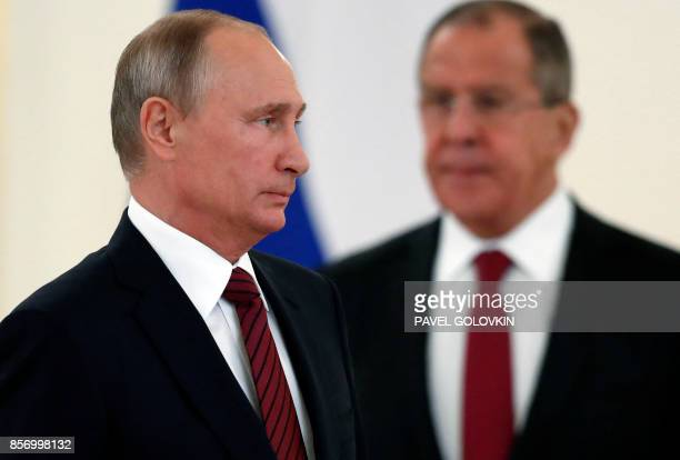 Russian President Vladimir Putin and Foreign Minister Sergei Lavrov attend a ceremony of receiving diplomatic credentials from foreign ambassadors at...
