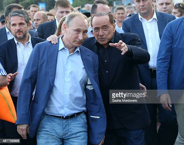 Russian President Vladimir Putin and Former Italain Prime Minister Silvio Berlusconi are seen during a joint walkabout on the streets on September 11...