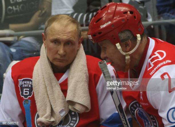 Russian President Vladimir Putin and former NHL player Slava Fetisov attend a gala match of the Night Hockey League teams at the Bolshoy ice arena at...