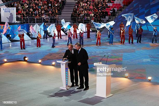 Russian president Vladimir Putin and former skier JeanClaude Killy hit the countdown button during the 'Sochi 2014 One Year To Go' ceremony at...
