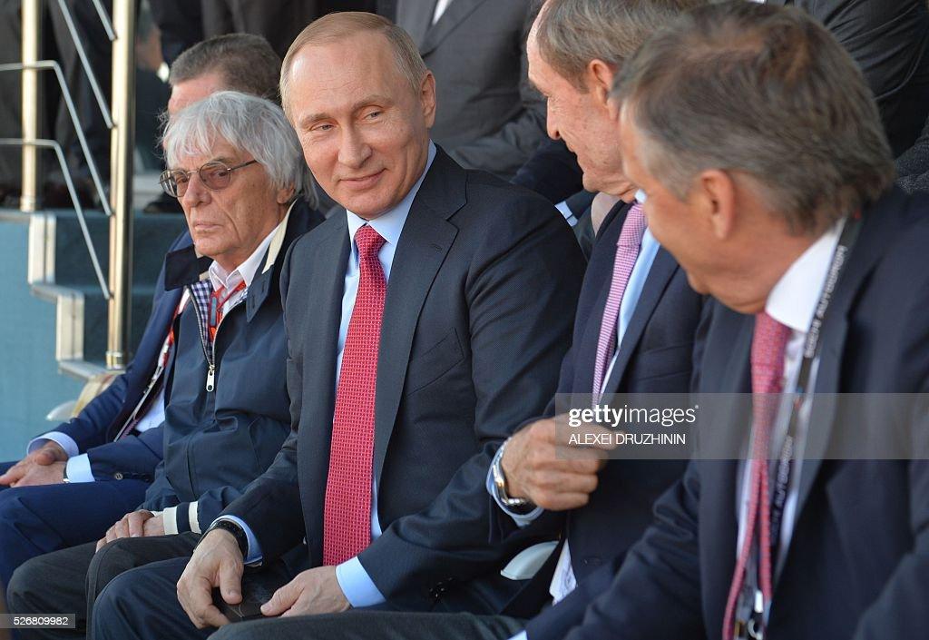 Russian President Vladimir Putin and Formula 1 boss Bernie Ecclestone attend the Formula One Russian Grand Prix at the Sochi Autodrom circuit on May...