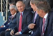 Russian President Vladimir Putin and Formula 1 boss Bernie Ecclestone attend the Formula One Russian Grand Prix at the Sochi Autodrom circuit on May...