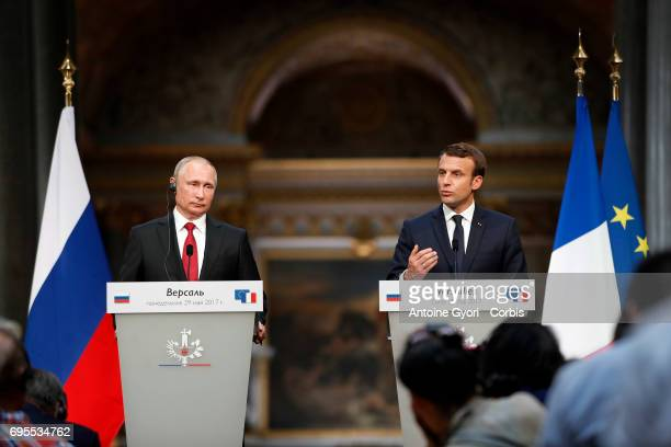 Russian President Vladimir Putin and French President Emmanuel Macron hold a joint press conference at 'Chateau de Versailles' on May 29 2017 in...