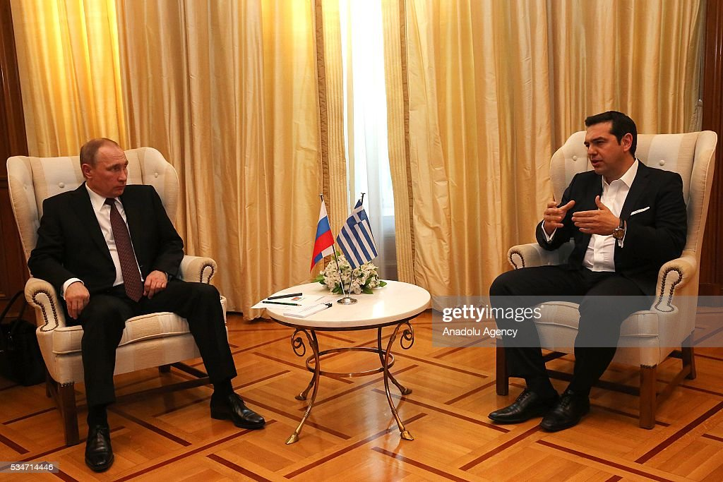 Russian President Vladimir Putin (L) and Greek Prime Minister Alexis Tsipras (R) meet in Athens, Greece on May 27, 2016.
