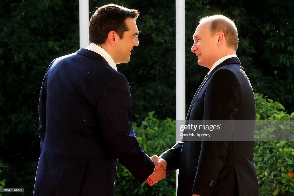Russian President Vladimir Putin (R) and Greek Prime Minister Alexis Tsipras (L) meet in Athens, Greece on May 27, 2016.