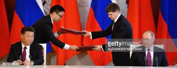 TOPSHOT Russian President Vladimir Putin and his Chinese Xi Jinping attend a signing ceremony in the Kremlin in Moscow on July 4 2017 The two leader...