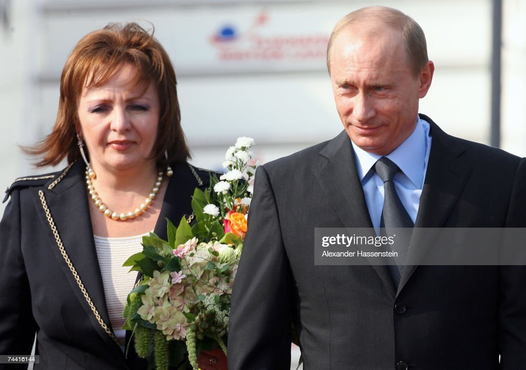 Russian President <a gi-track='captionPersonalityLinkClicked' href=/galleries/search?phrase=Vladimir+Putin&family=editorial&specificpeople=154896 ng-click='$event.stopPropagation()'>Vladimir Putin</a> and his wife Ludmila Alexandrowa Putina arrive at the airport on June 6, 2007 in Rostock-Laage, Germany. Putin, along with leaders from the leading industrial countries, developing countries and several African heads of state, is attending the G8 summit in Heiligendamm.