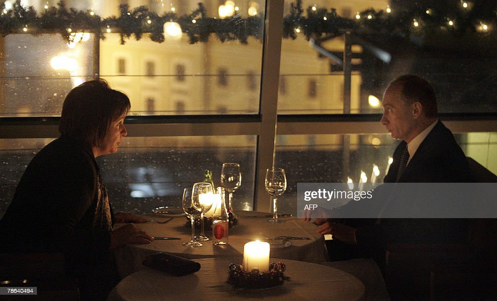 Russian President <a gi-track='captionPersonalityLinkClicked' href=/galleries/search?phrase=Vladimir+Putin&family=editorial&specificpeople=154896 ng-click='$event.stopPropagation()'>Vladimir Putin</a> and his wife Lyudmila have dinner at a restaurant in St. Petersburg, late 22 December 2007. Russian President <a gi-track='captionPersonalityLinkClicked' href=/galleries/search?phrase=Vladimir+Putin&family=editorial&specificpeople=154896 ng-click='$event.stopPropagation()'>Vladimir Putin</a> quipped on Friday that he would rather take things easy after eight years in power but new job offers keep getting in the way.