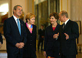 Russian President Vladimir Putin and his wife Lyudmila Putin talk with US President George W Bush and his wife Laura during a tour of the Hermitage...