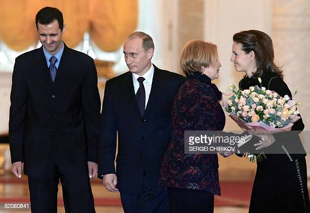 Russian President Vladimir Putin and his wife Lyudmila welcome Syrian President Bashar alAsad and his wife Asma before their meeting in the Moscow's...