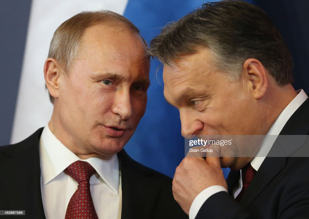 Russian President Vladimir Putin (L) and Hungarian Prime Minister <a gi-track='captionPersonalityLinkClicked' href=/galleries/search?phrase=Viktor+Orban&family=editorial&specificpeople=4685765 ng-click='$event.stopPropagation()'>Viktor Orban</a> converse during a signing ceremony of several agreements between the two countries at Parliament on February 17, 2015 in Budapest, Hungary. Putin is in Budapest on a one-day visit, his first visit to an EU-member country since he attended ceremonies marking the 70th anniversary of the D-Day invasions in France in June, 2014.
