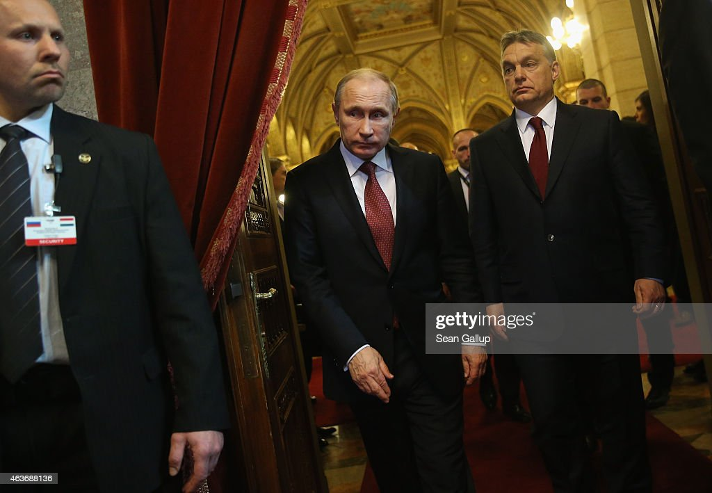 Russian President <a gi-track='captionPersonalityLinkClicked' href=/galleries/search?phrase=Vladimir+Putin&family=editorial&specificpeople=154896 ng-click='$event.stopPropagation()'>Vladimir Putin</a> (C) and Hungarian Prime Minister <a gi-track='captionPersonalityLinkClicked' href=/galleries/search?phrase=Viktor+Orban&family=editorial&specificpeople=4685765 ng-click='$event.stopPropagation()'>Viktor Orban</a> (R) arrive to speak to the media following lengthy talks at Parliament on February 17, 2015 in Budapest, Hungary. Putin is in Budapest on a one-day visit, his first visit to an EU-member country since he attended ceremonies marking the 70th anniversary of the D-Day invasions in France in June, 2014.