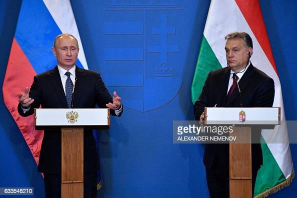 Russian President Vladimir Putin and Hungarian Prime Minister Viktor Orban give a joint press conference at the parliament building in Budapest on...