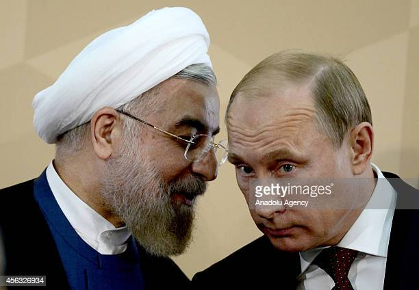 Russian President Vladimir Putin and Iranian President Hassan Rouhani meet during the 4th Caspian Summit on September 29 2014 in Astrakhan Russia...