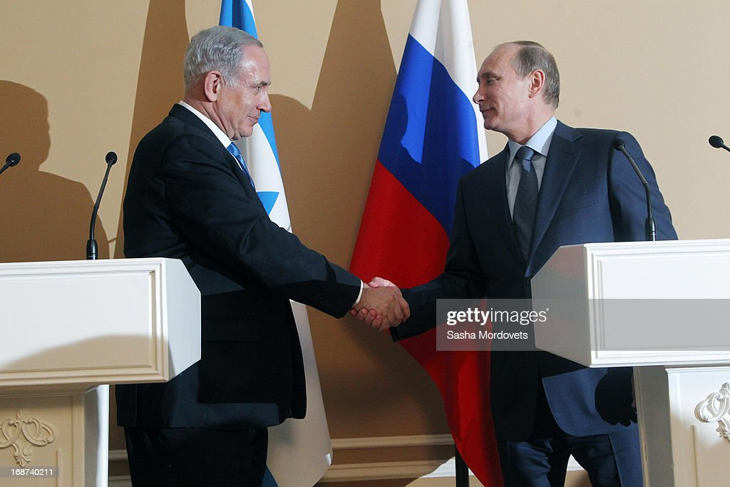 Russian President <a gi-track='captionPersonalityLinkClicked' href=/galleries/search?phrase=Vladimir+Putin&family=editorial&specificpeople=154896 ng-click='$event.stopPropagation()'>Vladimir Putin</a> (R) and Israeli Prime Minister <a gi-track='captionPersonalityLinkClicked' href=/galleries/search?phrase=Benjamin+Netanyahu&family=editorial&specificpeople=118594 ng-click='$event.stopPropagation()'>Benjamin Netanyahu</a> shake hands as they hold a joint press conference at Bocharov Ruchei state residence on May 14, 2013 in Sochi, Russia. According to reports, Israel's concerns over Russian plans to sell Syrian President Bashar al-Assad an advanced air defense system will be raised.