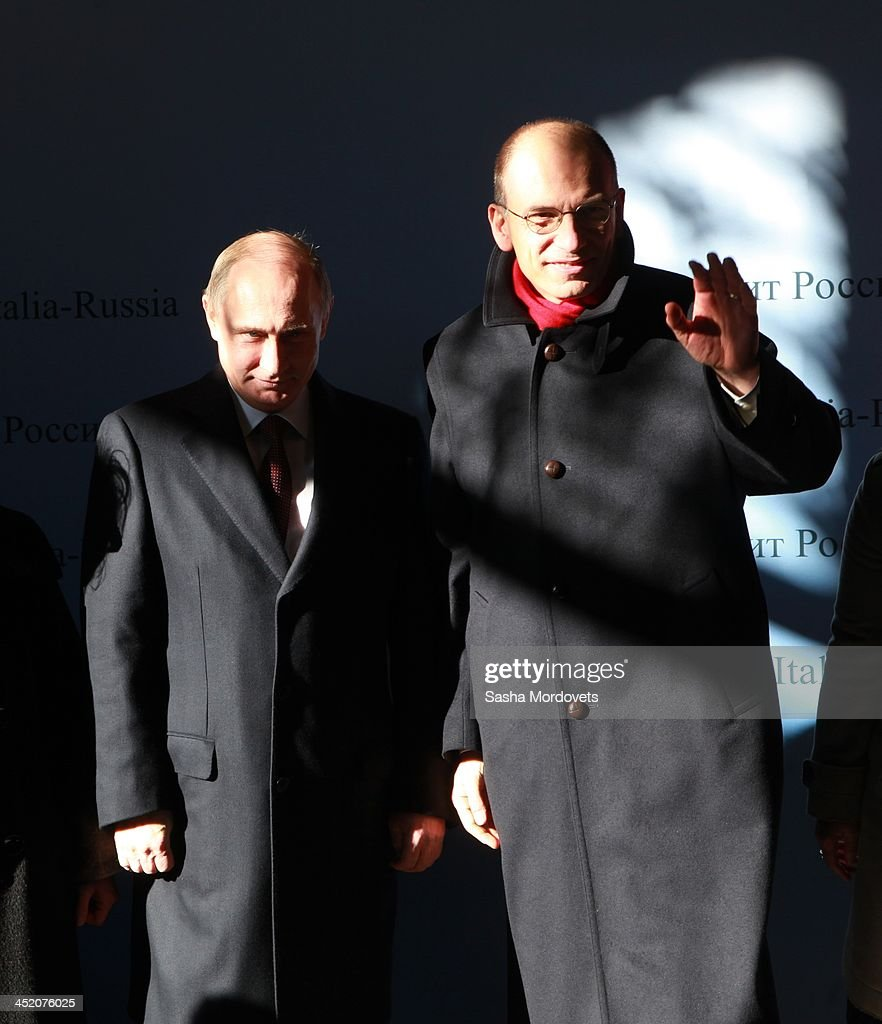 Russian President <a gi-track='captionPersonalityLinkClicked' href=/galleries/search?phrase=Vladimir+Putin&family=editorial&specificpeople=154896 ng-click='$event.stopPropagation()'>Vladimir Putin</a> (L) and Italian Prime Minister <a gi-track='captionPersonalityLinkClicked' href=/galleries/search?phrase=Enrico+Letta&family=editorial&specificpeople=2915592 ng-click='$event.stopPropagation()'>Enrico Letta</a> (R) attend a welcome ceremony on November 26, 2013 in Trieste, Italy. Putin will hold meetings for the eighth round of high-level bilateral consultations ahead of a billion Euro international cooperation deal.