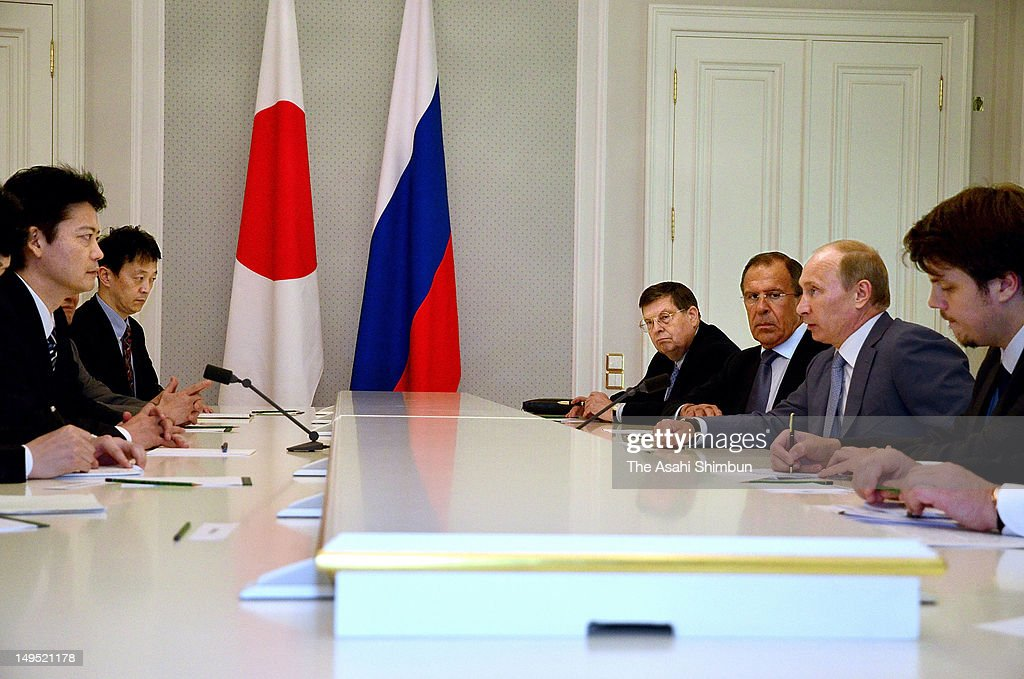 Russian President <a gi-track='captionPersonalityLinkClicked' href=/galleries/search?phrase=Vladimir+Putin&family=editorial&specificpeople=154896 ng-click='$event.stopPropagation()'>Vladimir Putin</a> (2R) and Japanese Foreign Minister <a gi-track='captionPersonalityLinkClicked' href=/galleries/search?phrase=Koichiro+Gemba&family=editorial&specificpeople=7046304 ng-click='$event.stopPropagation()'>Koichiro Gemba</a> (1L) speak during their meeting on July 28, 2012 in Sochi, Russia.
