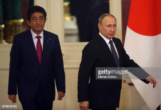 Russian President Vladimir Putin and Japanese Prime Minister Shinzo Abe ente the hall during their talks at the Grand Kremlin Palace on April 27 2017...